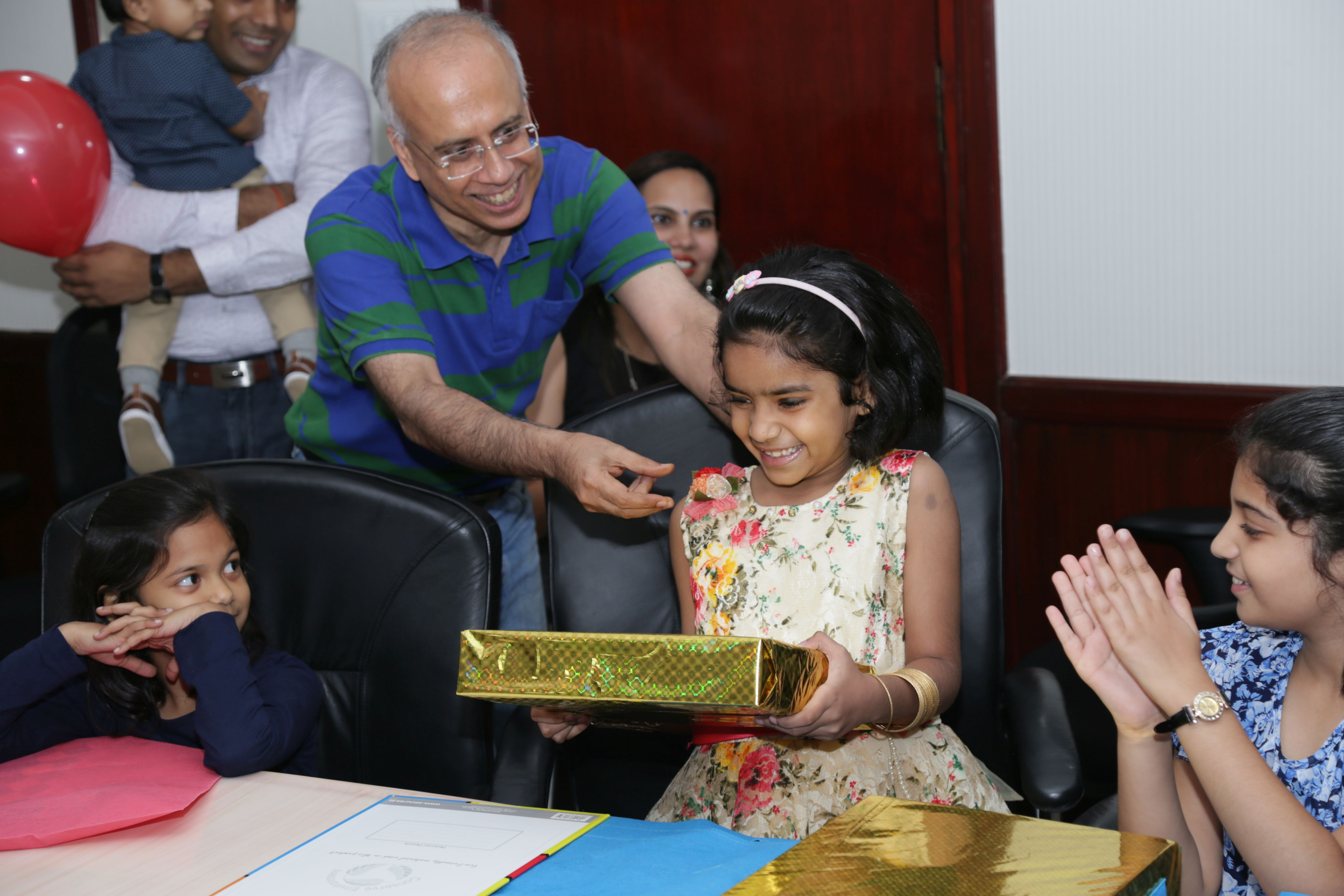 Prize distribution by Director Finance to children Photo Gallery